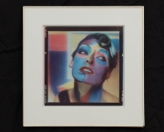 1992 series also for Vogue features close-ups of Canadian supermodel Linda Evangelista, her face painted in color blocks of cherry red, teal blue, bubblegum pink and saffron in the style of renowned Expressionist painter Alexej Jawlensky.